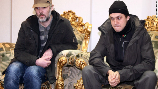 Two British journalists captured by a Libyan militia in late February have been freed, the UK government said Sunday.