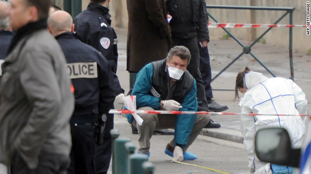 Police collect evidence near the Jewish school in Toulouse, France, where four people were shot dead.