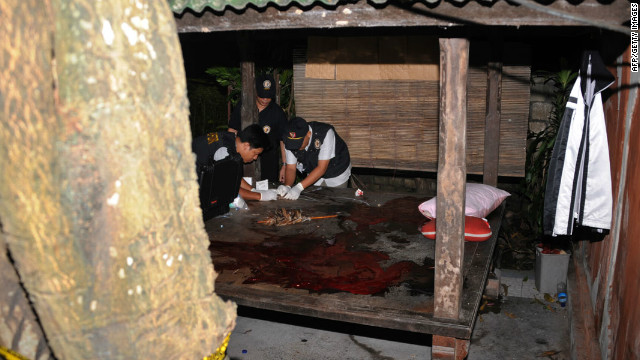 Indonesian counter-terrorism police personnel look for clues at a bungalow after the shoot-out on the island of Bali.