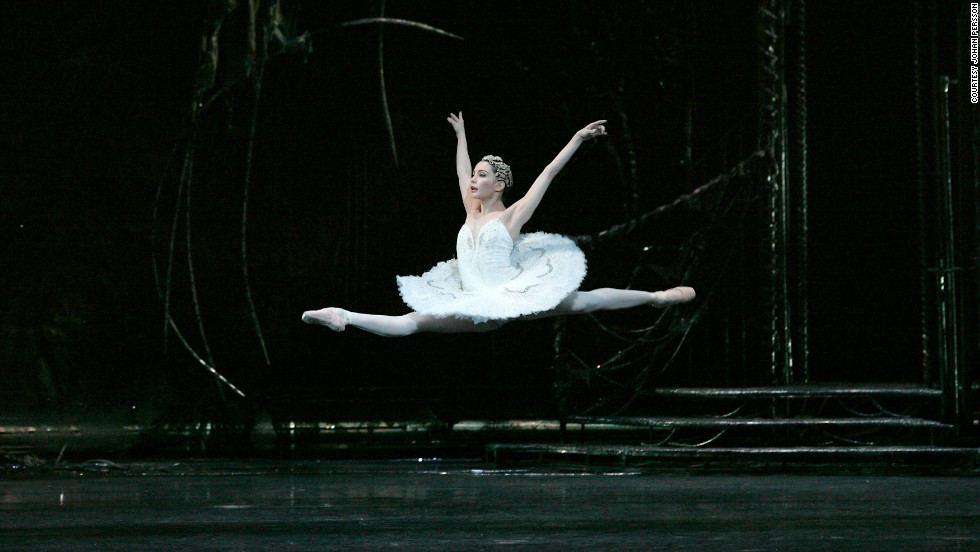 "Tamara Rojo has garnered consistent praise for her athletic blend of technique and artistry. Here she is seen mid-flight in the execution of a ""grand jeté"" during a performance as Odette in Tchaikovsky's Swan Lake."