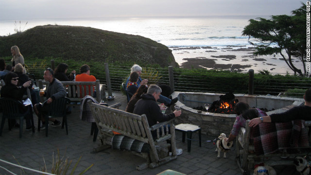 Moss Beach Distillery's Seal Cove Patio invites dogs to cozy up by the fire pit and dine on grilled hot dogs.
