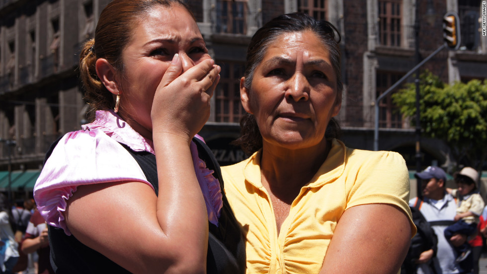 A woman comforts another at El Zocalo square in Mexico City on Tuesday after a 7.4-magnitude earthquake struck southwest Mexico, causing residents in the capital several hundred miles away to rush out onto the streets. The quake struck near the tourist resort of Acapulco, just after midday some 25 kilometers northeast of the town of Ometepec, the U.S. Geological Survey said.
