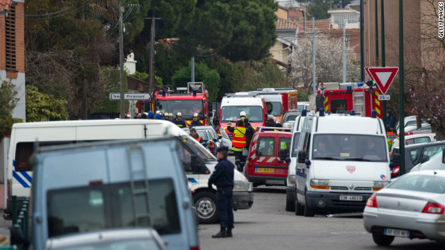 Two officers were injured as police surrounded a property during a raid to arrest 23-year-old Mohammed Merah in Toulouse, France on Wednesday.