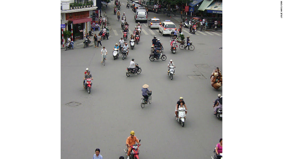 Motorbike traffic floods the streets of Hanoi's Old Quarter.
