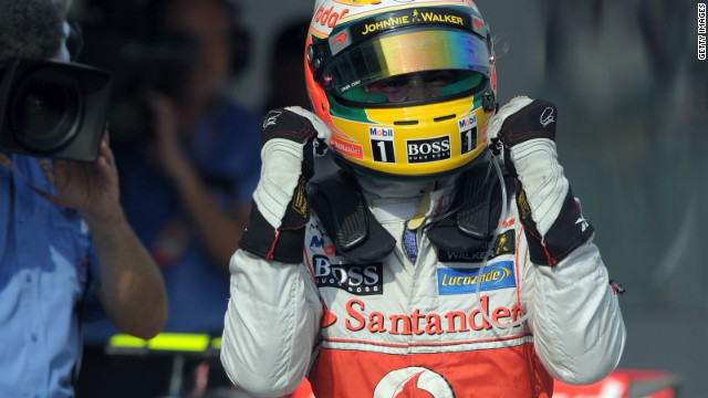 A jubilant Lewis Hamilton celebrates his pole position at Sepang for the Malaysian Grand Prix.