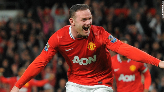 Wayne Rooney celebrates his goal just before halftime in the English Premier League game against Fulham.