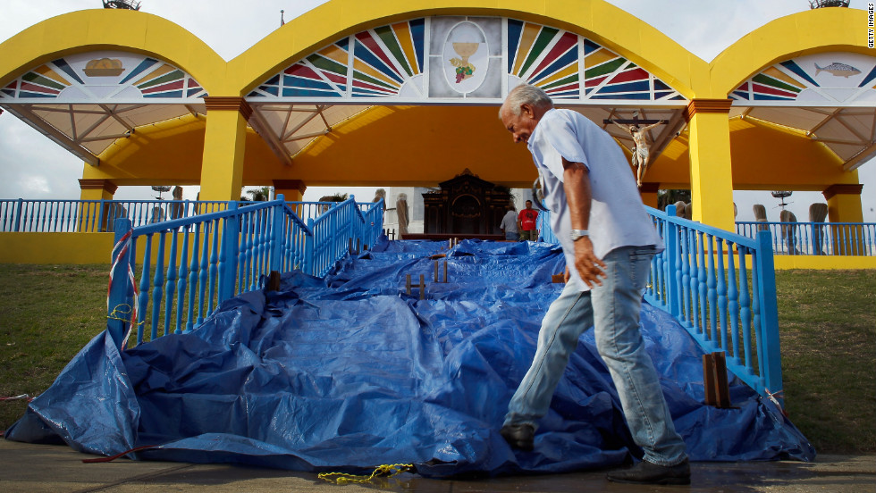 A worker prepares a stage for the arrival of the pope. He wil mark the 400th anniversary of Cuba's patroness, the Virgin of Charity of El Cobre.