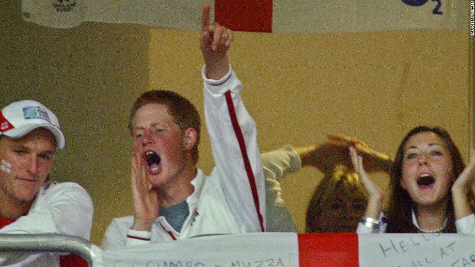November 2003: Prince Harry celebrates after England won the Rugby World Cup final at the Olympic Park Stadium in Sydney.