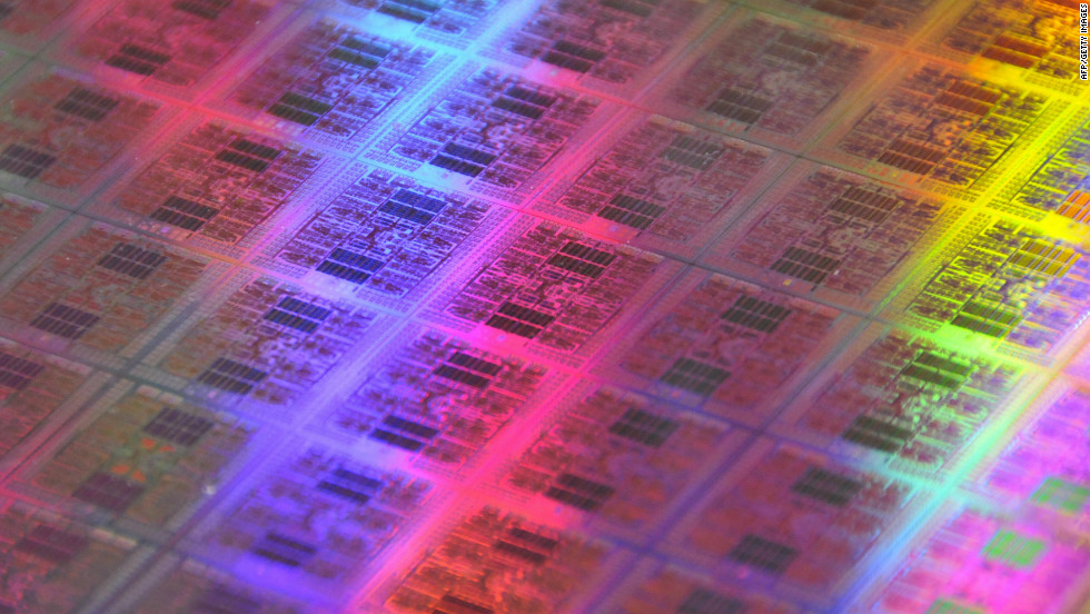 A wafer of traditional computer chips containing transistors.