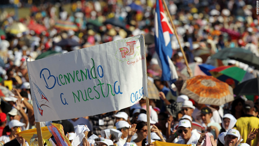 People await the arrival of Pope Benedict XVI in Revolution Square in Santiago de Cuba.