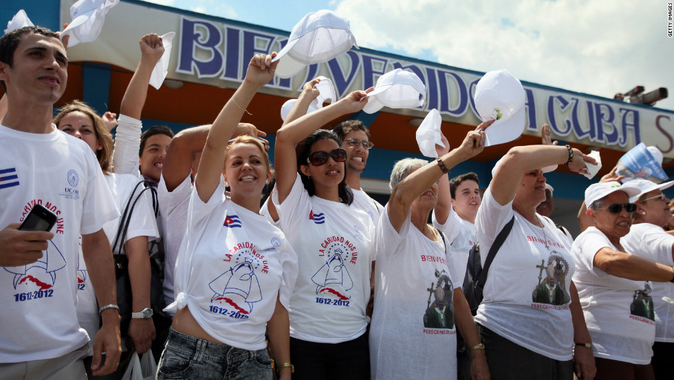People cheer as the pope arrives at Jose Marti International Airport on the second day of his three-day visit.