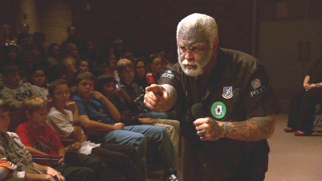 The Scary Guy talks to students in Austin, Minnesota.