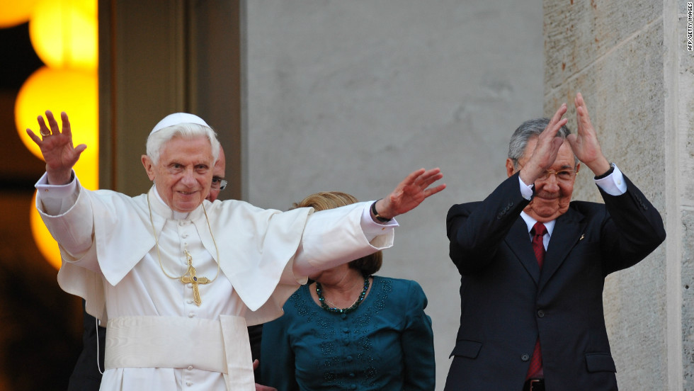 Pope Benedict XVI and Cuban President Raul Castro wave at the Revolution Palace in Havana, on Tuesday.