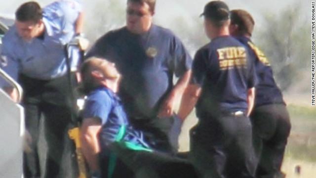 JetBlue pilot Clayton Osbon is taken off his plane last week.