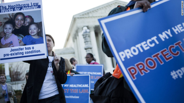 People rally to protect health care reforms on March 26 outside the Supreme Court as it hears arguments on the health care act.