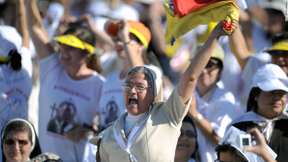 A nun celebrates before the arrival of the pope.