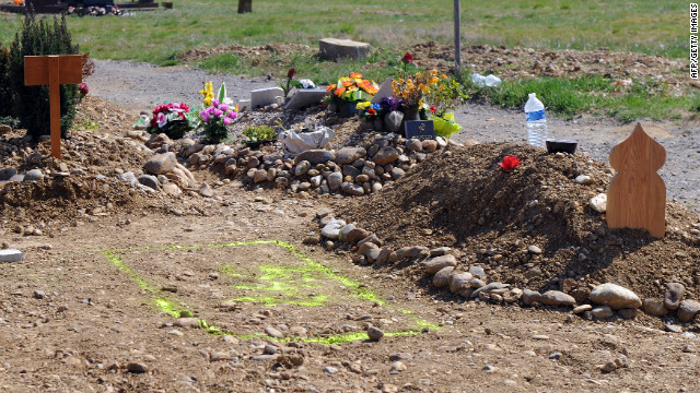 Municipal workers prepare a hole in Toulouse a cemetery where the body of Mohamed Merah may be buried.