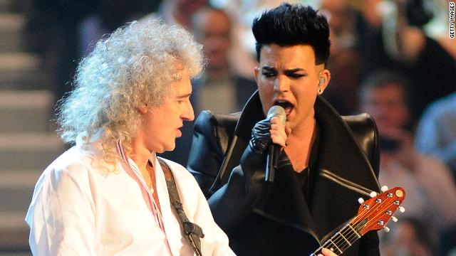 Brian May of Queen (left) and Adam Lambert perform at the MTV Europe Music Awards 2011 in Belfast, Northern Ireland.