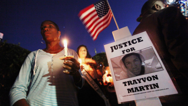 Supporters gather during a vigil for Trayvon Martin outside gated community where he was shot.