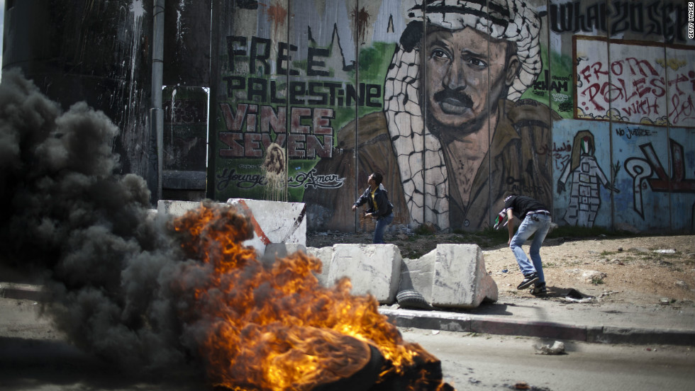 Protesters burn tires during clashes near the Qalandia military checkpoint in West Bank on Friday.