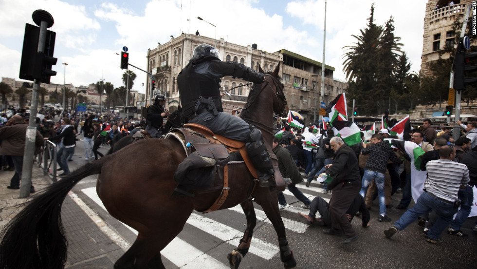 An Israeli mounted policeman disperses hundreds of Palestinian protesters during a demonstration in east Jerusalem on Friday.