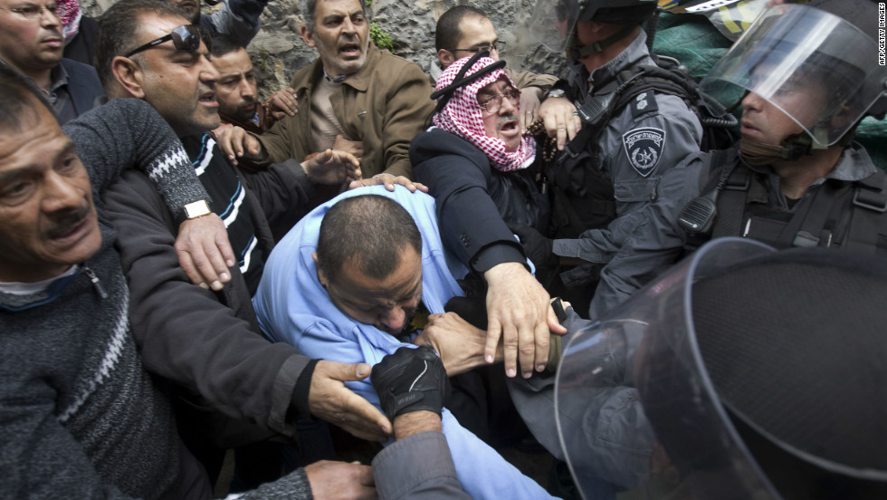 Palestinians scuffle with Israeli policemen during a demonstration marking Land Day in east Jerusalem on Friday.