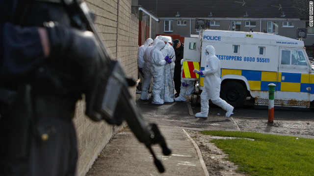 (file photo) Police search houses near to where gunmen shot Stephen Carroll on March 12, 2009 in Craigavon, Northern Ireland.