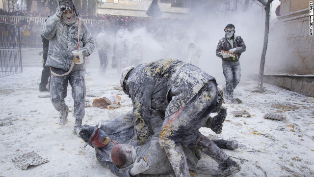 Revelers take part in the battle of Els Enfarinats, which is thick with flour and eggs, in the town of Ibi, Spain.