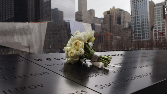 A bouquet of roses lies at the World Trade Center Memorial in New York.