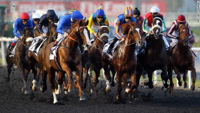 Jockeys compete in the UAE Derby during the Dubai World Cup on March 31, 2012.