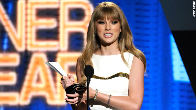 Singer Taylor Swift accepts the entertainer of the year award Sunday night in Las Vegas.