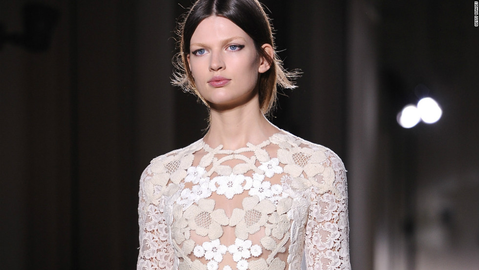 Valentino brought back white in a big way for spring. This diaphanous lace dress is one of the season's most popular trends.