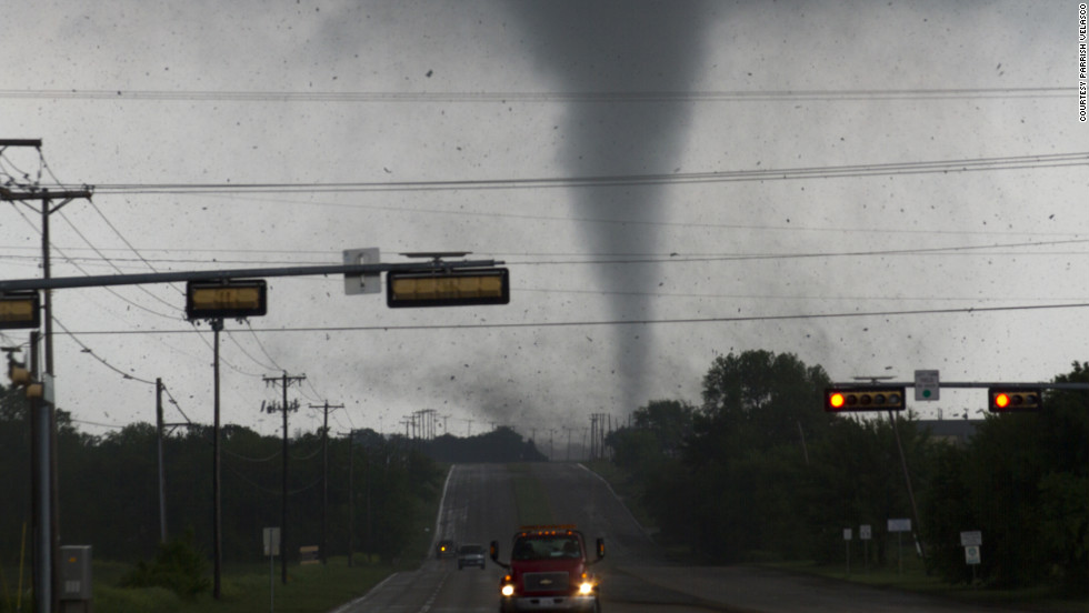A tornado touches down in Lancaster, Texas, on Tuesday. Multiple tornadoes ripped through the Dallas-Fort Worth area, causing extensive damage.