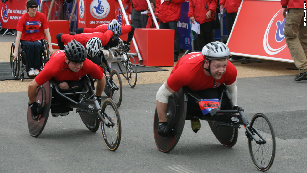 Wheelchair racers were among the competitors following a route which took them past many of the Olympic venues, including the velodrome and the aquatics center.