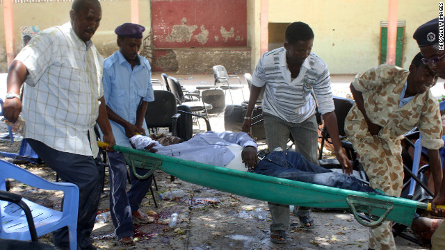 A victim of a suicide attack is carried on a stretcher on April 4, 2012 in Mogadishu.