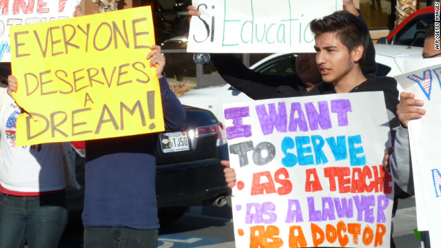 Young Latino protesters hold placards outside Mitt Romney' s Nevada campaign headquarters in Las Vegas in February