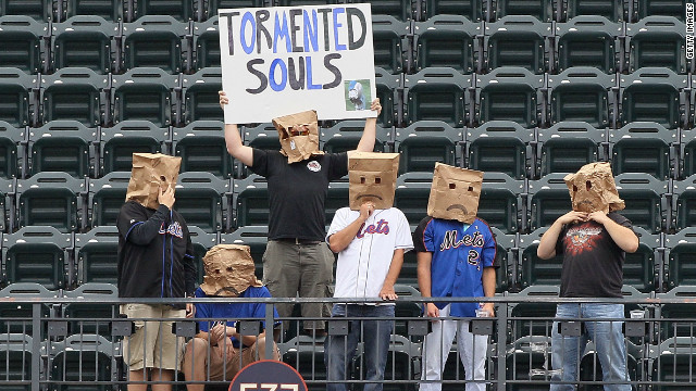 New York Mets fans watch the game against the Cincinnati Reds at Citi Field on September 28, 2011 in New York City.