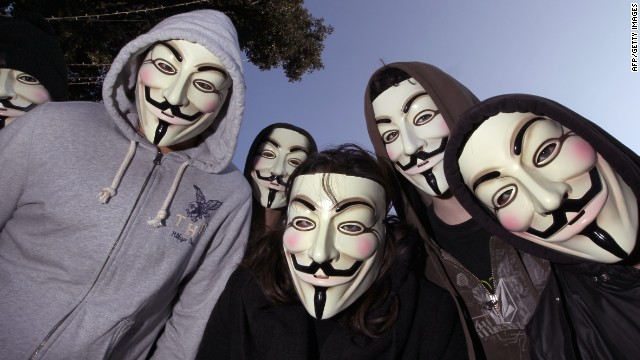 "Protesters in  ""Guy Fawkes"" masks favored by the Anonymous hackers group pose at a demonstration in February."