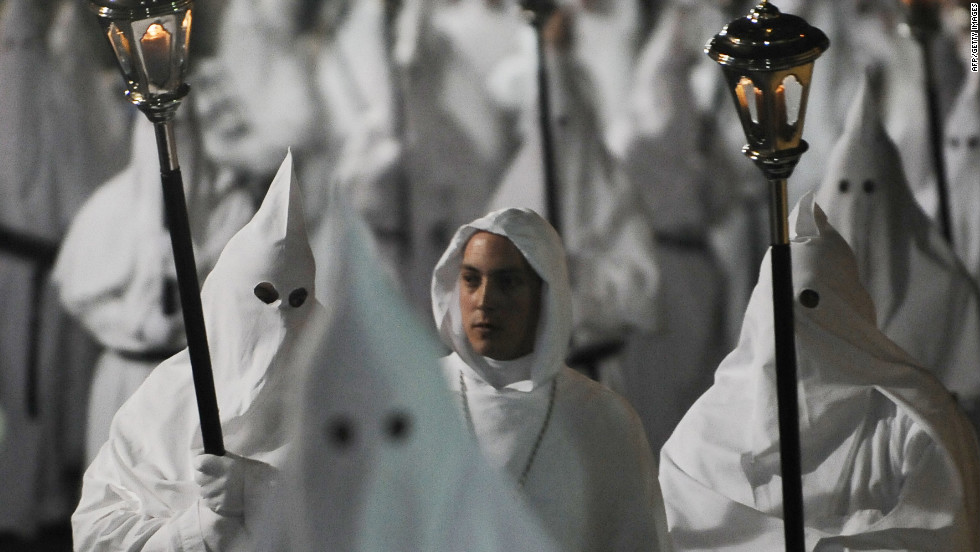 Penitents join a Good Friday procession in Sorrento, Italy.