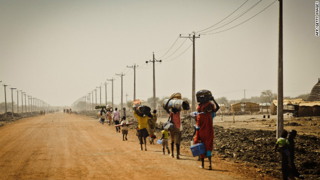 Sudanese people flee the disputed oil-rich Abyei area on March 2, 2011, before the independence of South Sudan on July 9.