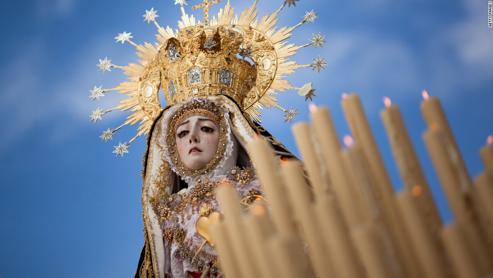 The Nuestra Senora de los Dolores Coronada, of the Dolores brotherhood, heads down a street during a Holy Week procession Friday in Cordoba, Spain.