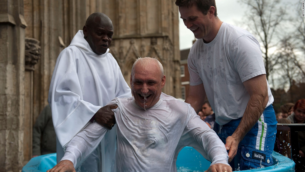 Archbishop of York John Sentamu, left, baptizes a local churchgoer during an Easter ceremony Saturday in York, England. The baptism of adults by total immersion is a ritual signifying the death of a believer's old life and a rebirth in Christ. Easter Sunday celebrates the resurrection of Jesus three days after his execution on the cross.