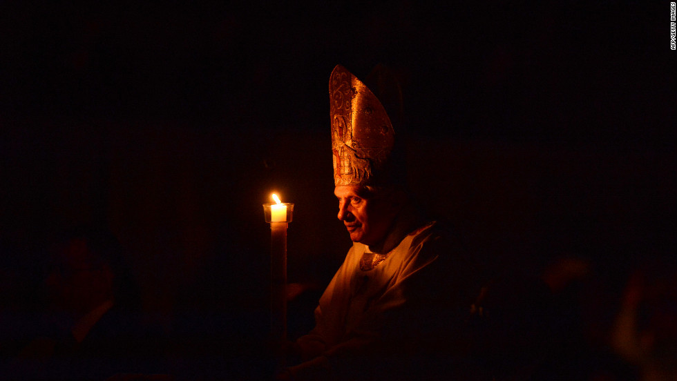 Pope Benedict XVI holds a candle during the Easter Vigil on Holy Saturday at St Peter's Basilica at the Vatican.