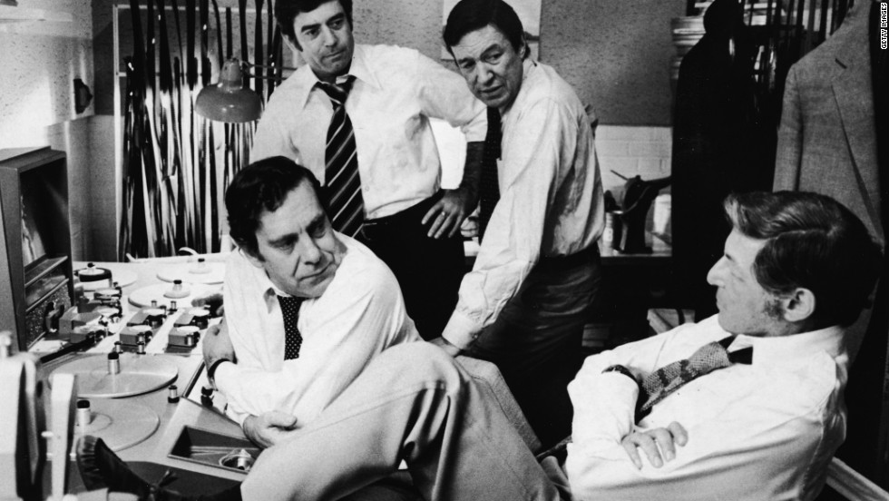 """60 minutes"" correspondents Morley Safer, from left, Dan Rather and Mike Wallace, and executive producer Don Hewitt, right, discuss upcoming segments during the 1970s."