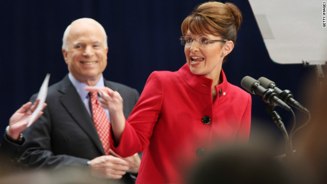 Republican presidential nominee Sen. John McCain, left, listens as running mate Alaska Gov. Sarah Palin speaks in Ohio in 2008.