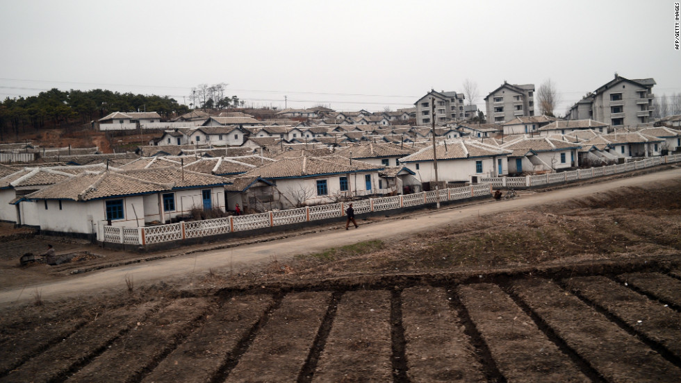 The train passes by a small town on the way to the Sohae Satellite Launching Station in Tongchang in the country's north-west.