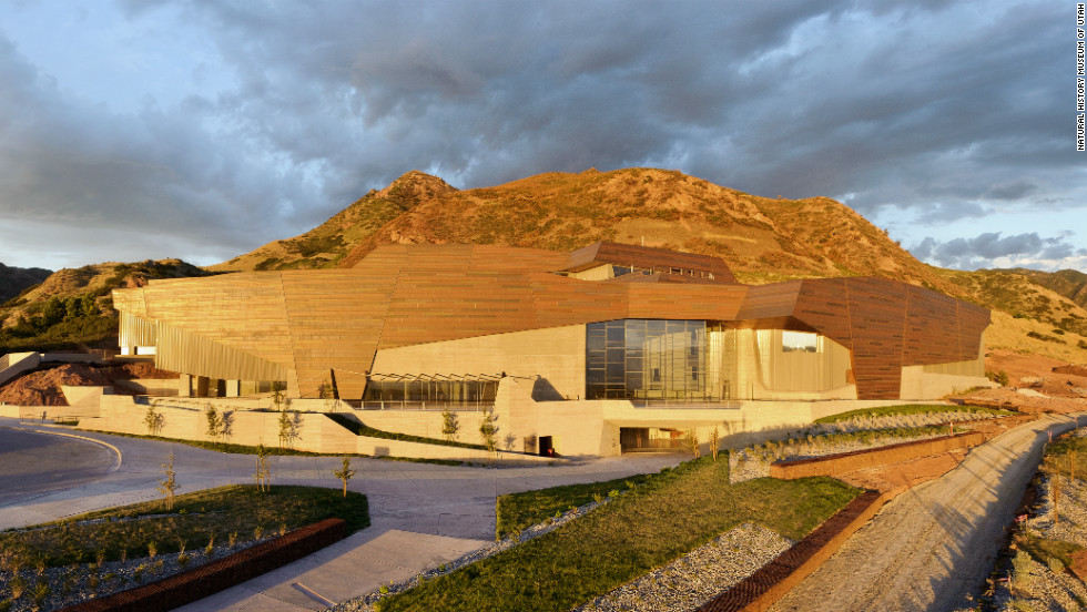 The setting sun illuminates the copper façade on the Rio Tinto Center, the Natural History Museum of Utah's new building. The copper is offset in sections to represent the state's geology.