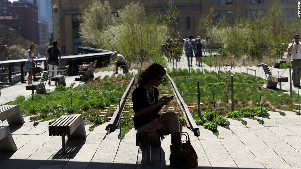 People take in the warm weather at the High Line, Manhattan's newest park constructed on a former elevated railroad track.