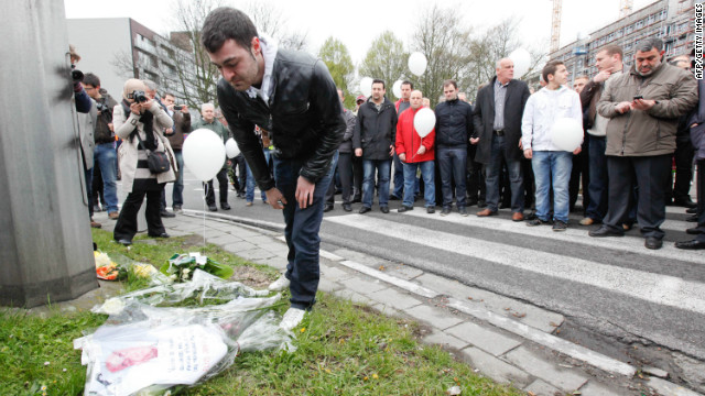 People lay flowers at the site in Brussels, Belgium where a transport worker was beaten to death on April 7.