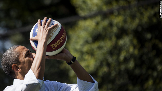 US President Barack Obama shoots a basketball while participating in a basketball station with the Harlem Globetrotters during the annual Easter Egg Roll on the South Lawn of the White House April 9, 2012 in Washington, DC. The First Family participated in the yearly event where the South Lawn is opened up to guests to participate in various egg rolls and other activities. AFP PHOTO/Brendan SMIALOWSKI (Photo credit should read BRENDAN SMIALOWSKI/AFP/Getty Images)